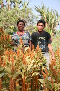 Program director Julian Vasquez Chun and his grandmother with their gorgeous amaranth plants, representing a resurgence of Mayan culture